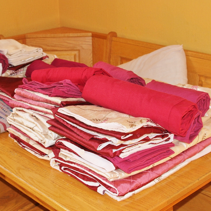 Freshly laundered bed linen for glamping site units