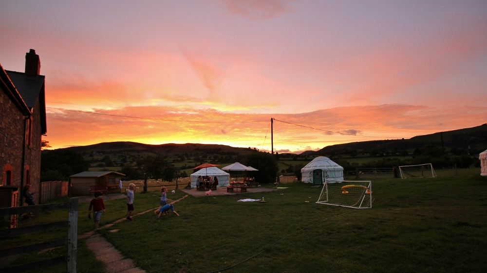 Sunset behind the yurt field.