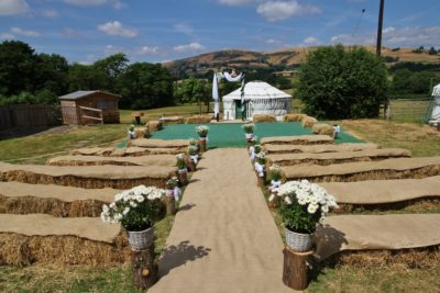 Outdoor wedding aisle from hay bales
