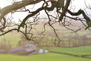 Barnutopia and the yurts from the hill behind Tanycoed Farm.