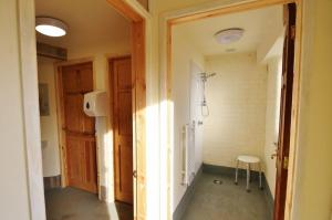 Shower cubicle and door to ladies' side.