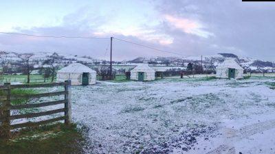 The yurt field in winter at Barnutopia