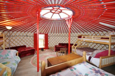 Beds and sofas in yurt Axana