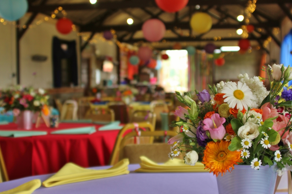 Rainbow venue decor at quirky wedding