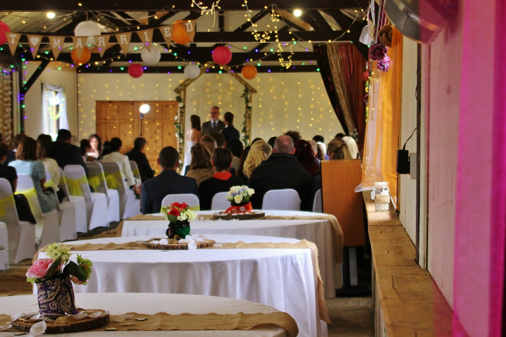 Autumn wedding ceremony in the long barn