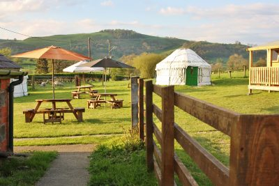 glamping accommodation yurt field