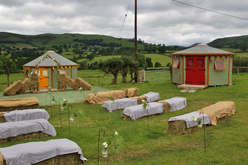 Hay bale seating on the yurt field